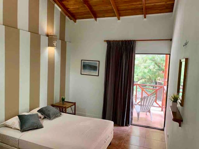 Private Room #1 with full bathroom and terrace overlooking the main road
