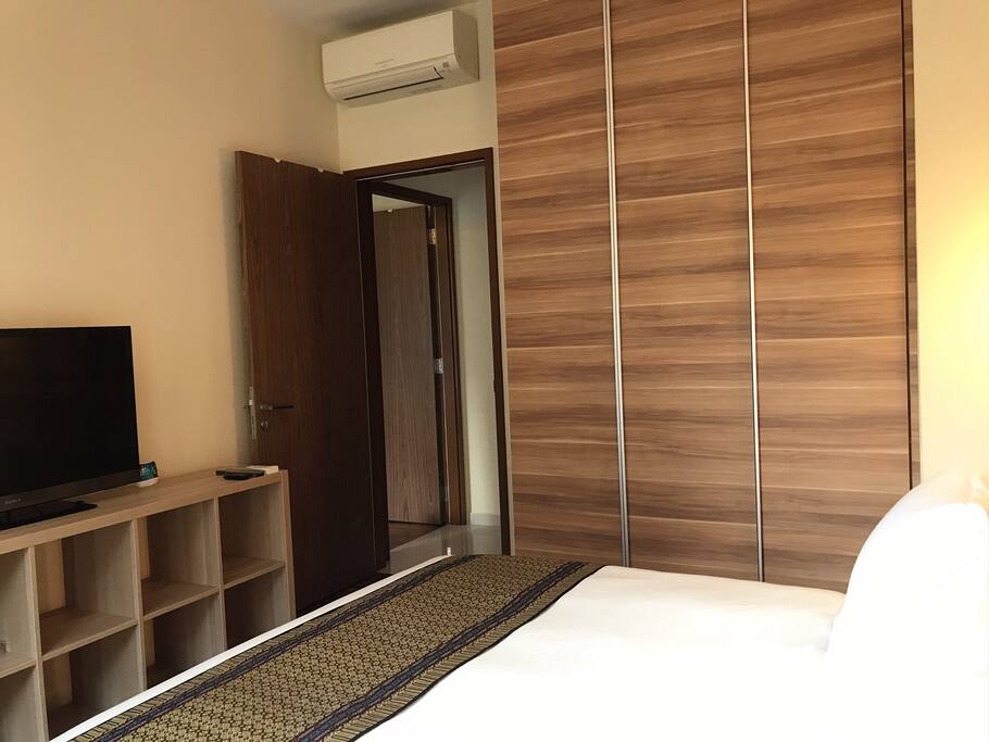 """The Queen Room (private) with wardrobe, inner drawers, AC, 40"""" Sony LED TV, and free wi-fi."""
