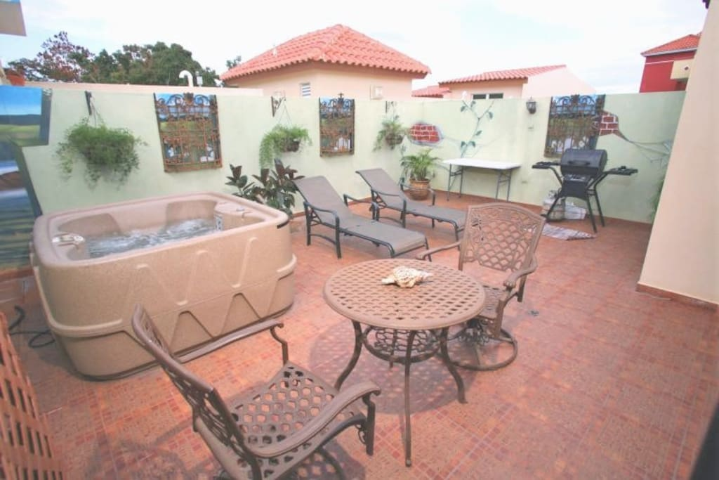 2 private terraces, this one with hot tub, lounge chairs, BBQ