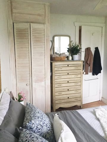 First bedroom, vintage chest & closet space.