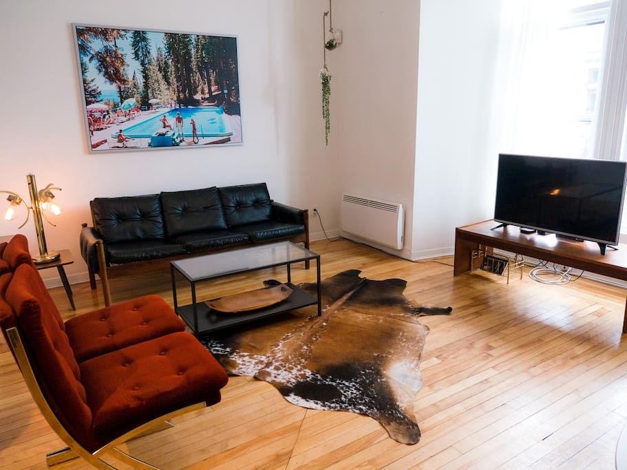 funky living room, with a flatscreen TV, appleTV, and Netflix account provided!