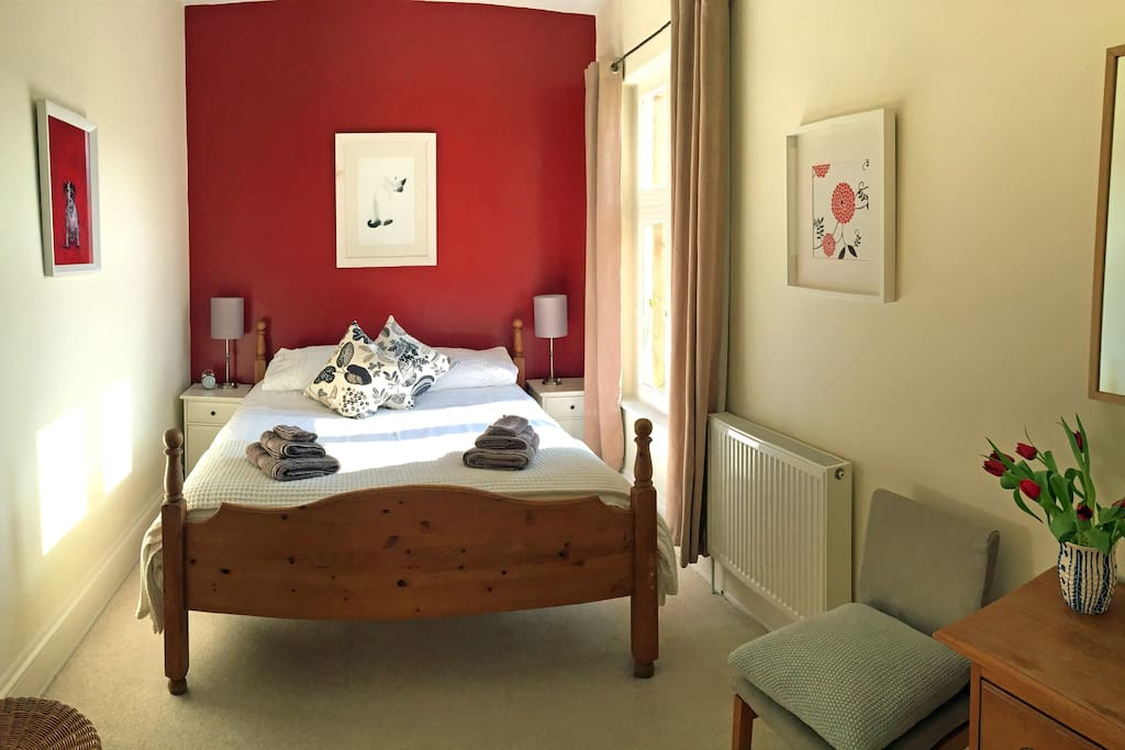 Double bedroom with comfy king size bed, hanging space, chest of drawers/dressing table
