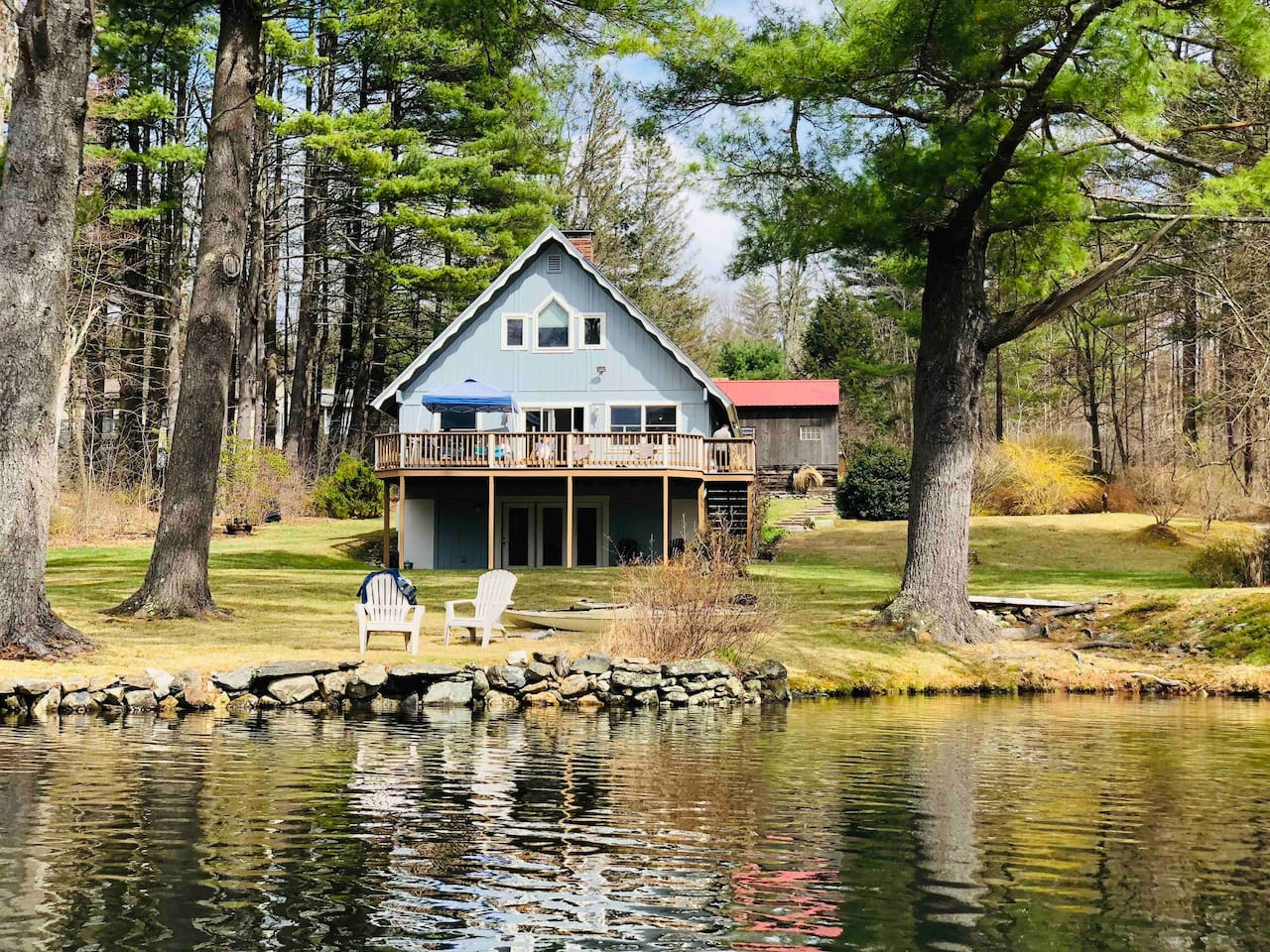 This is the view of the property from the lake in late April. Flat yard, direct easy access to the water with lots of privacy.  The deck faces the west so you get beautiful sunsets.