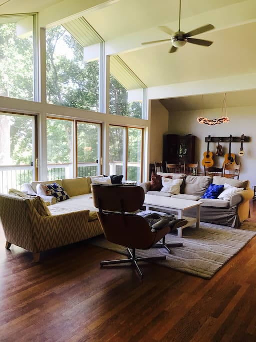 Living room with plenty of room for everyone to lounge. Wood stove, huge windows, great views.