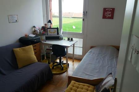 Chambre individuelle avec vue dégagée sur Beauvais