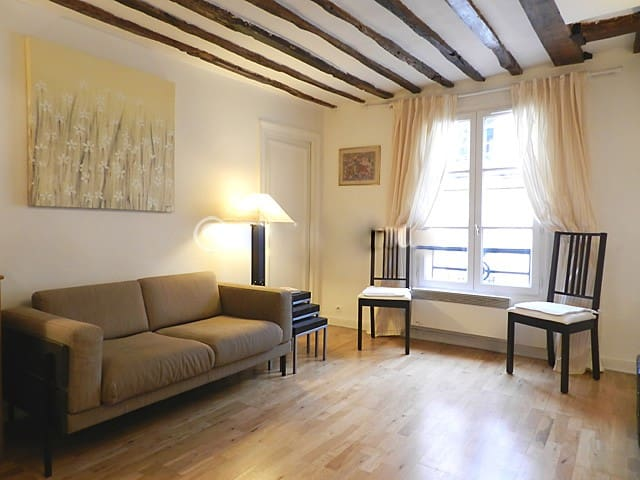 Living The 15 square meters living room has a double glazed window facing courtyard . It is equipped with : dining table for 4 people, sofa, coffee table, cable, TV, phone, decorative fireplace, hard wood floor.