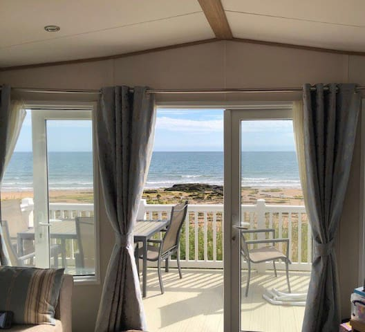 Beach front luxury caravan with stunning views