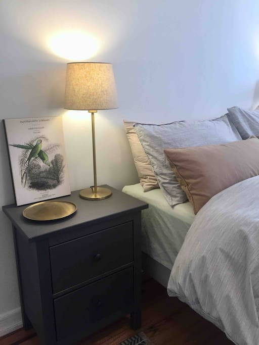 Comfortable bed with bedside tables and lights for reading