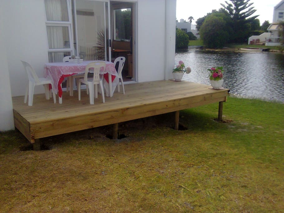 Spacious deck to spend hot summer evenings or enjoy early morning breakfasts