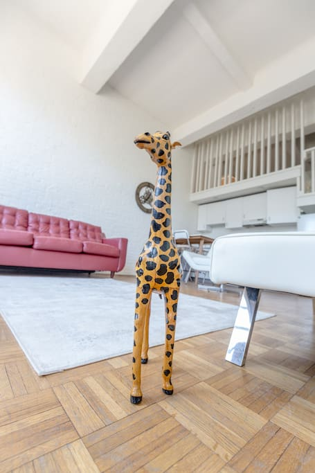 Post a picture with giraffe Stephan and tag it #forgethotels :)