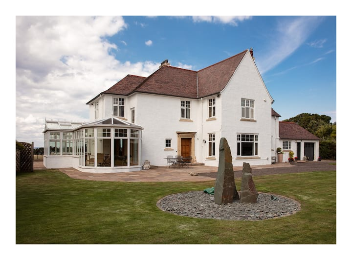 East Lothian Home with a golf course and sea view.