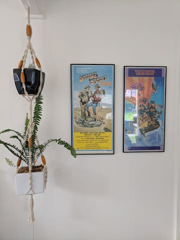 The apartment features retro decor such as these cool movie poster artworks.