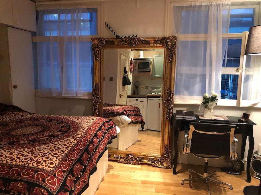 large mirror/ work desk/ double bed