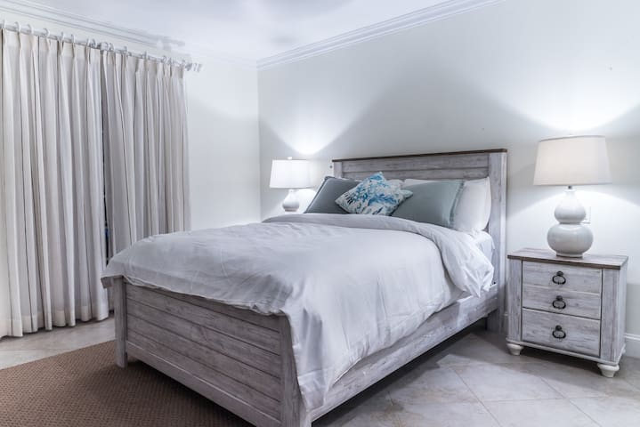 Downstairs Bedroom - Queen Bed, each side table offers USB chargers.