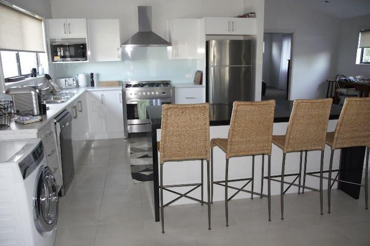 Large kitchen with granite kitchen bench
