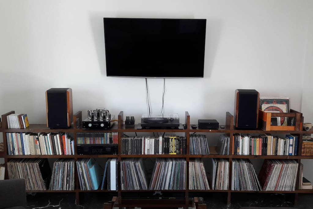 """Pro-Ject Debut III upgraded with Ortofon 2M Blue Cartridge, Pro-Ject Phono Stage & CD Player, Tsakiridis Aiolos 2x45W Tube Amplifier, Chario Constellation Delphinus Speakers and Sony Double Tape Deck (you can bring your mixtapes...). LG 50"""" WiFi TV with NETFLIX and Spotify subscription plus a collection of books and music that you can enjoy while staying here."""