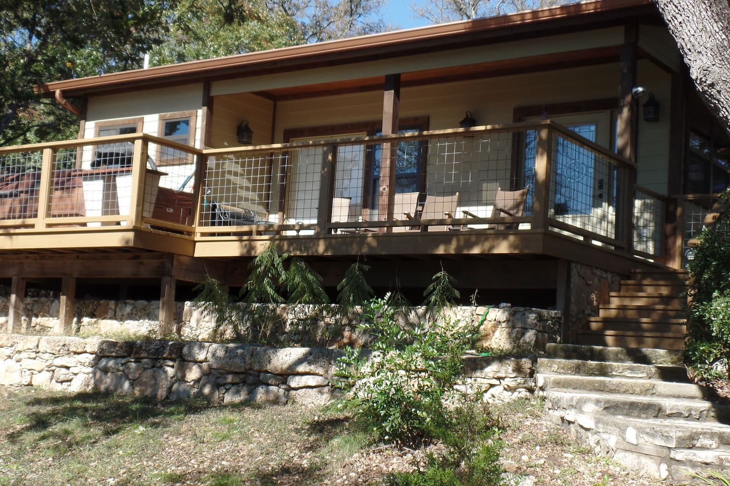 Home on the Range front view of private deck with hot tub, grill & rocking chairs.