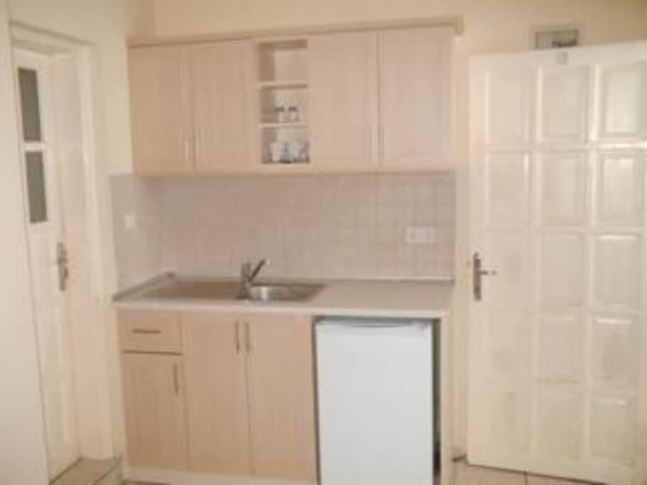 Kitchen with fridge, kettle, toaster, saucepans etc .....