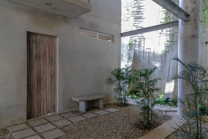 Bedroom entrance on garden level.  Each room has it's own key and a safe for your valuables.