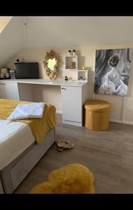 Luxuries double bedroom with shared bathroom