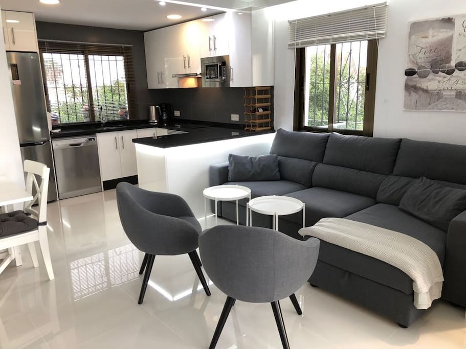 Fully equipped kitchen with dishwasher and lounge with sofa bed (panorama picture)