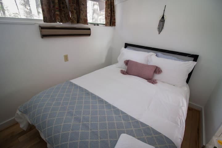 Upper bedroom.  Linens and pillows for your stay.  Curtains have been updated with light blocking curtains.