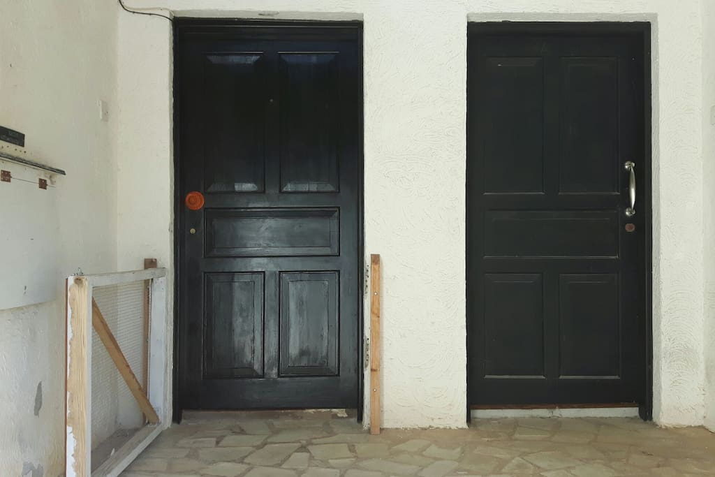 The entrance is the door on the left with the orange handle