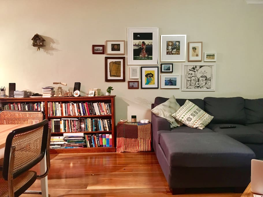 Living room with books galore.