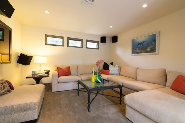 Entertainment Room: Premium Cable, Apple TV, 8 Speaker Surround Sound