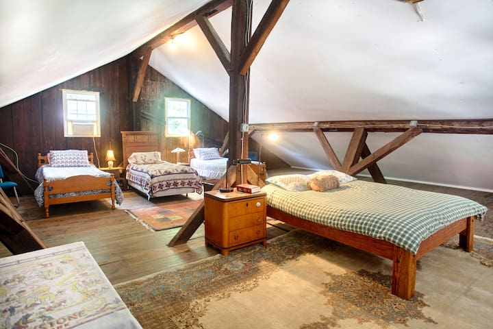 Unique sleeping loft with a queen-sized bed and three single beds