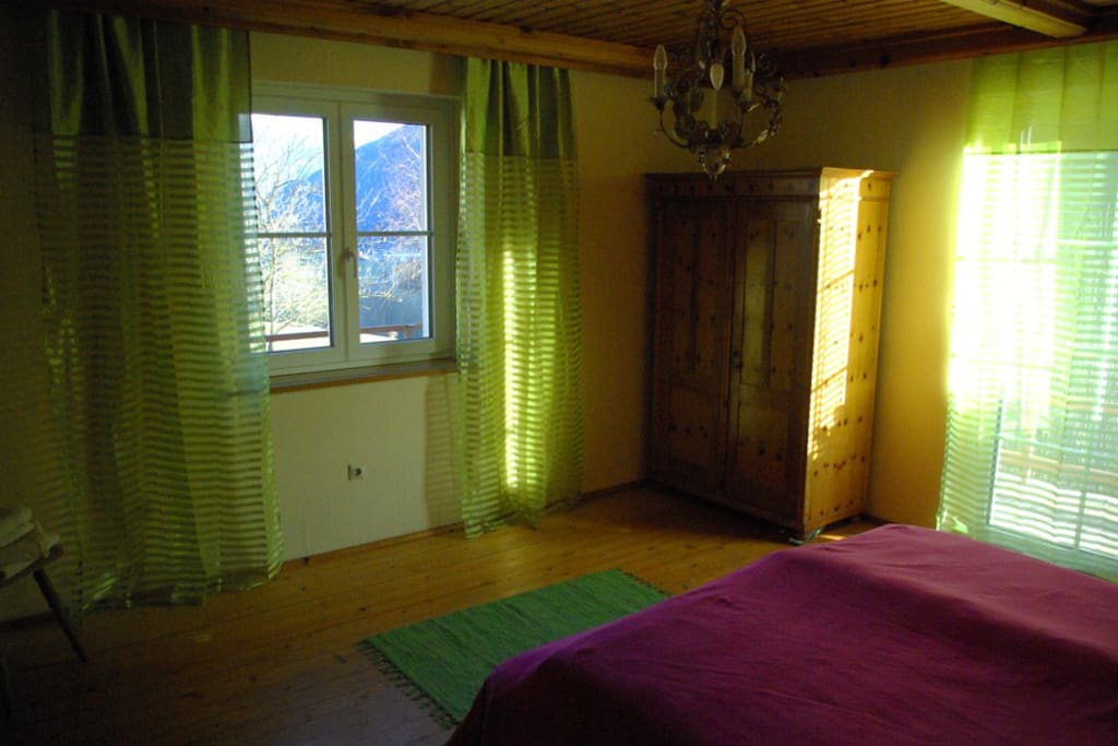 bedroom with balcony - view to snow headed mountains