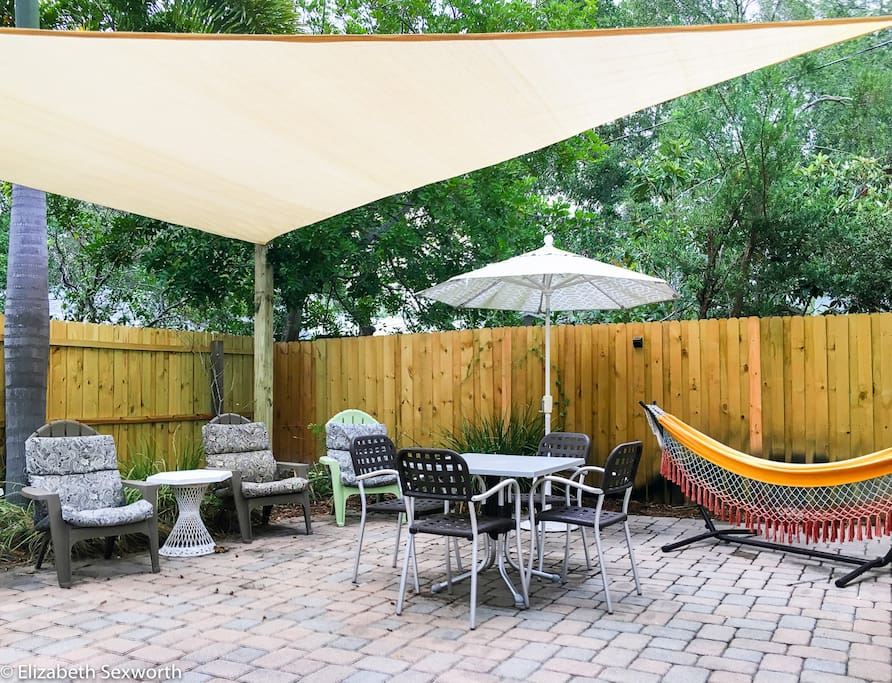 Large sail shade over dining and lounging areas
