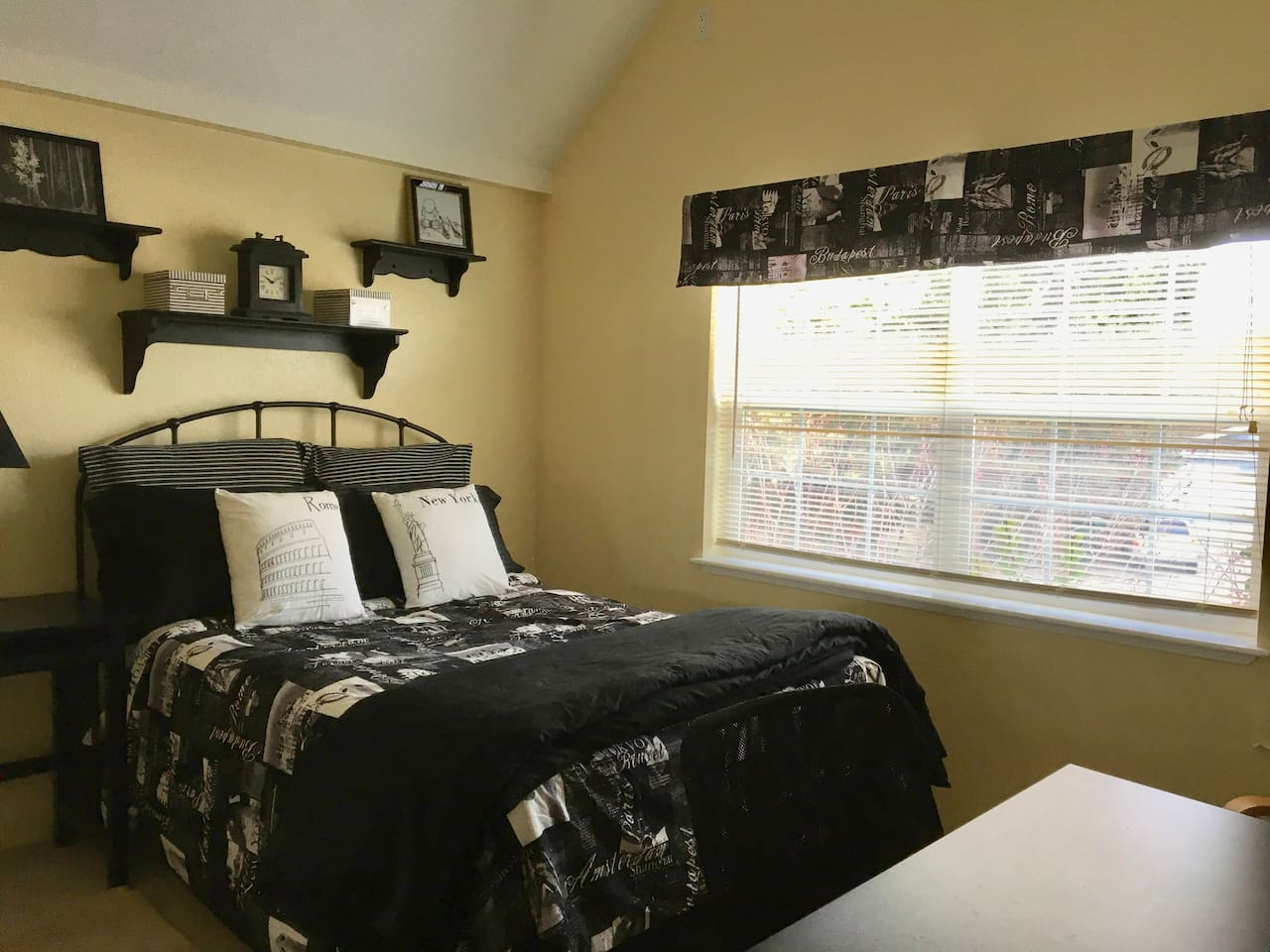 Bedroom Number l features a full-size comfy cozy bed, dresser, desk, chair/ ottoman and private bath.