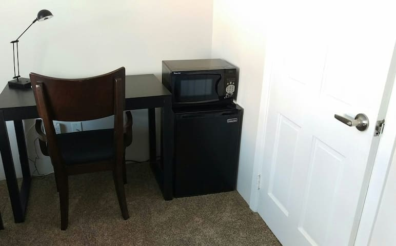 Workspace, wired internet, usb charging receptacle, refrigerator, and microwave