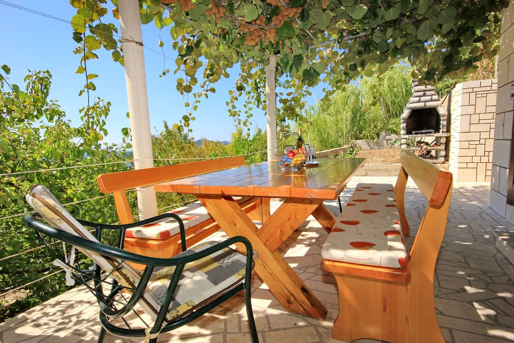 Terrace, table and barbecue