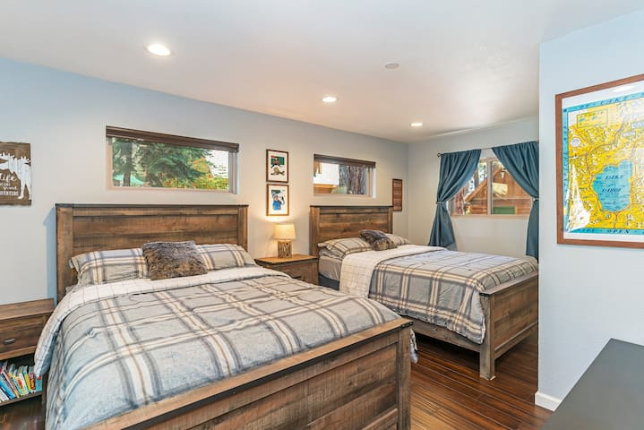 The second bedroom features two comfy queen-sized beds.