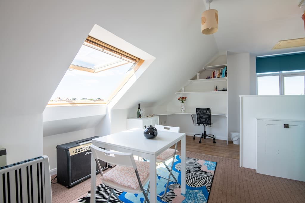 Velux windows, writing desk and dinning area