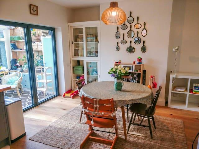 Open plan kitchen diner onto Conservatory