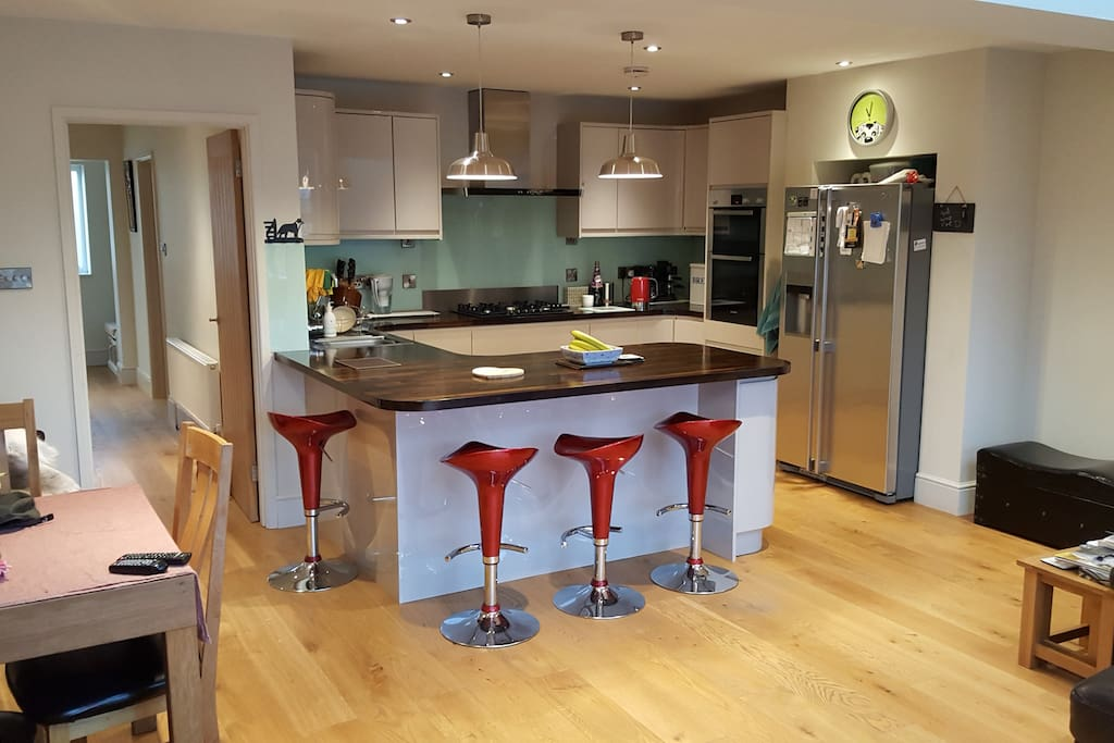 Contemporary kitchen with breakfast bar - perfect for preparing and cooking local Cotswold delicacies