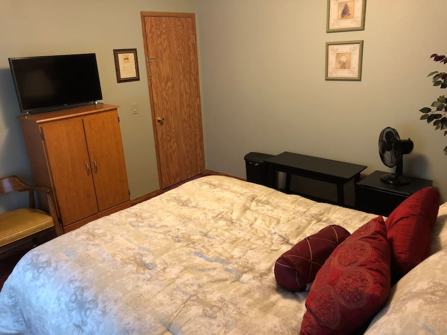 "Your guest room with mini refrigerator, fan, luggage stand, and 32"" flat screen smart tv ready with Netflix."