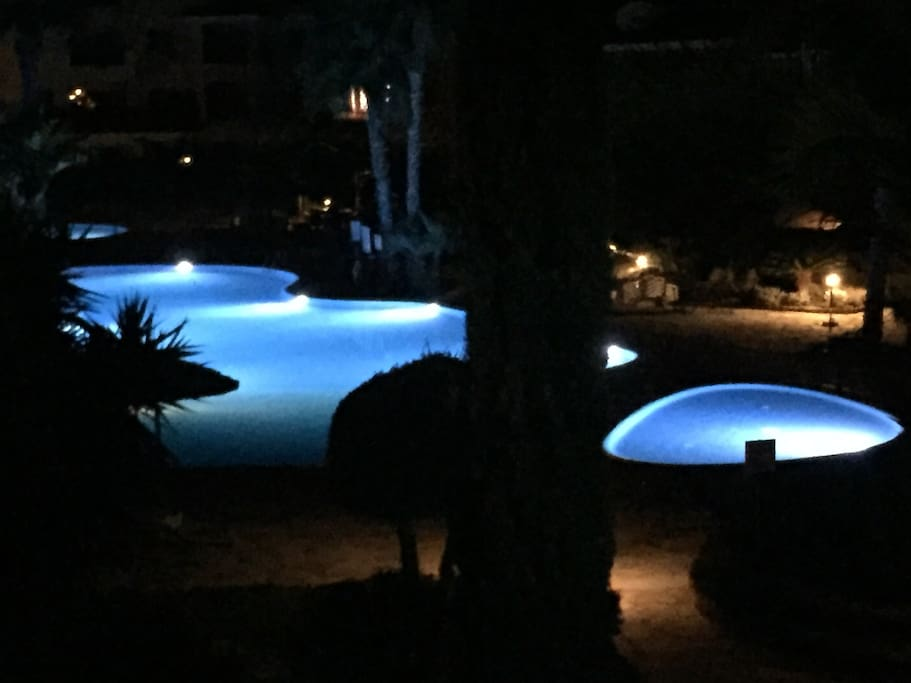 Pools and gardens at night from our large private terrace