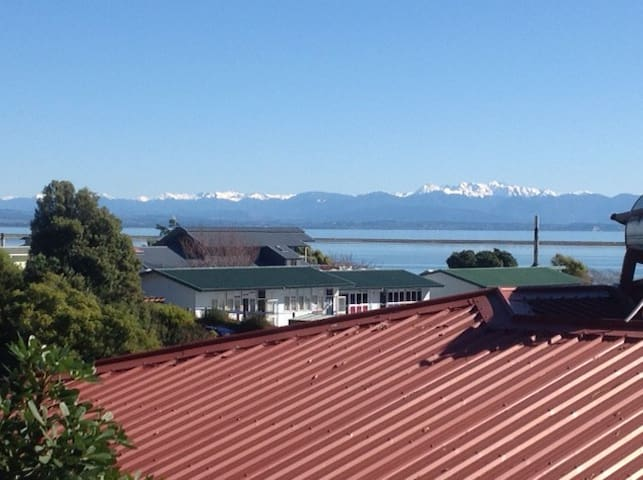 Just one view from balcony of the haven and Tasman Bay with snow-covered mountains.