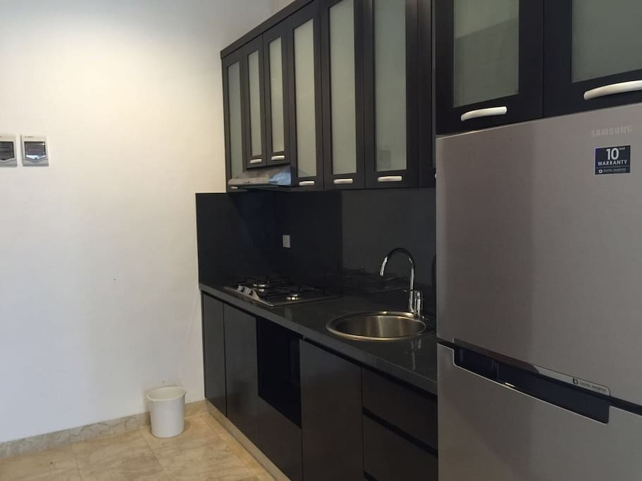Fully equipped kitchen set with stove,sink,fridge and built in cupboard