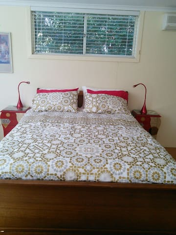 Comfortable queen bed with reading lights