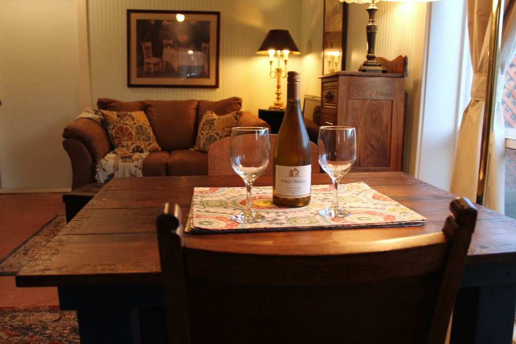 Dining Area and Living Room.  Wine, anyone? Your complimentary bottle awaits.