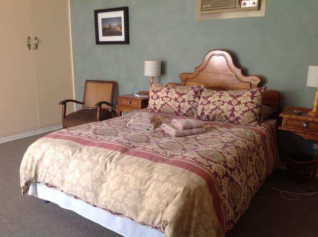 The main bedroom with en suite bathroom.  Main bedroom