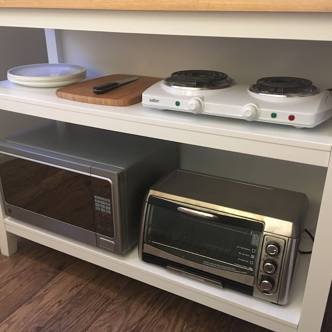 Dual burner, countertop oven and microwave.