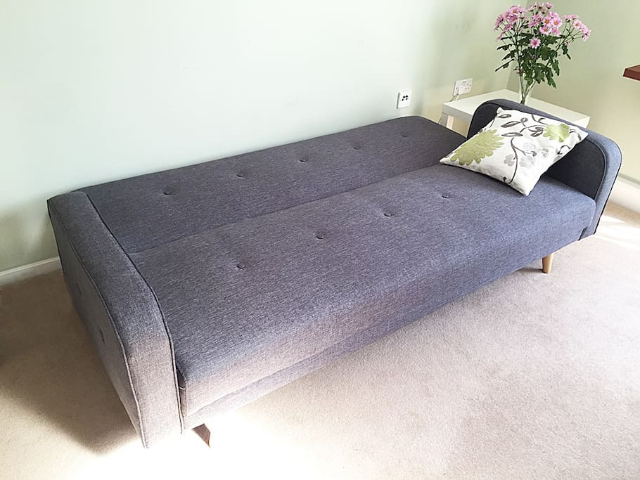 Sofa folded out as double bed - can accommodate another person comfortably