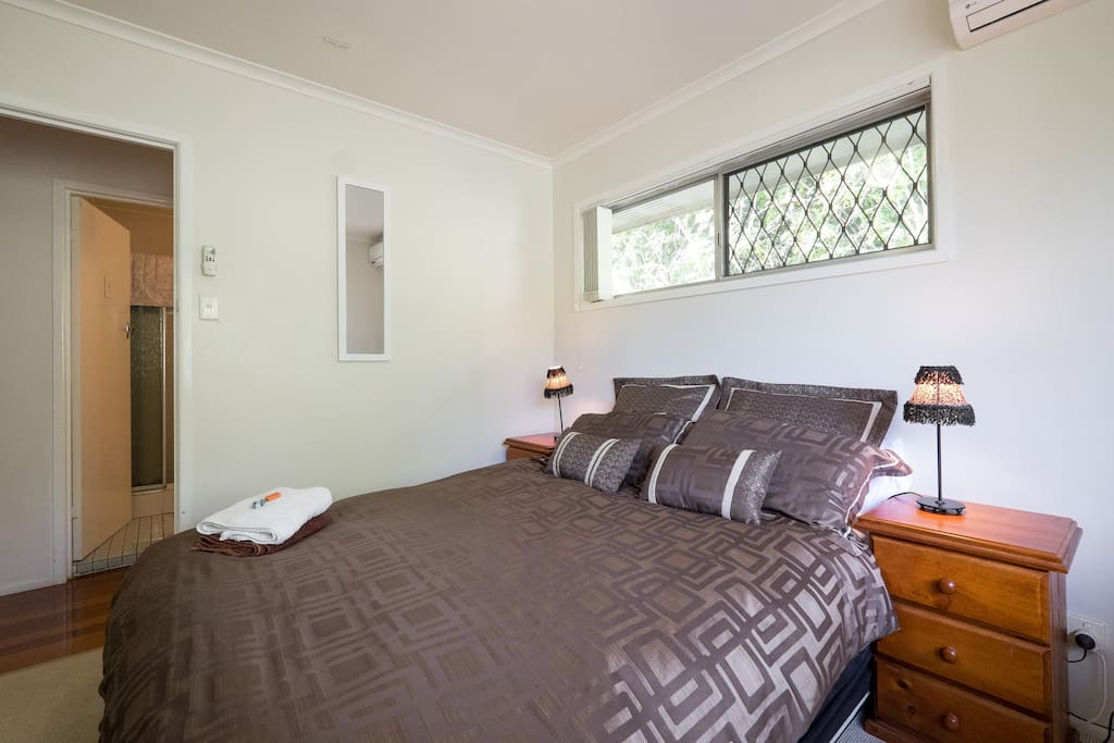 Comfy bedroom with built in wardrobe and aircon