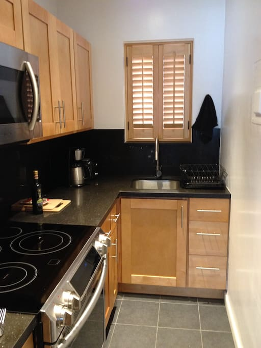 Kitchen stainless steel appliance, custom wood cabinets, granite counter-tops